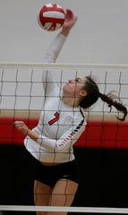 Lourdes Academy's Rachel Aasby spikes the ball during their match against Valley Christian on Sept. 25.