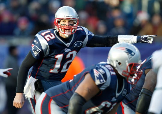 New England Patriots quarterback Tom Brady (12) yells out at the line of scrimmage during the third quarter of an NFL football game  against the Miami Dolphins  at Gillette Stadium in Foxborough, Mass. Saturday, Dec. 24, 2011. (AP Photo/Charles Krupa) ORG XMIT: FBO506