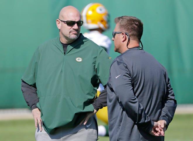 Green Bay Packers defensive coordinator Mike Pettine talks to GM Brian Gutekunst during practice at Clarke Hinkle Field on Wednesday, September 26, 2018 in Ashwaubenon, Wis.