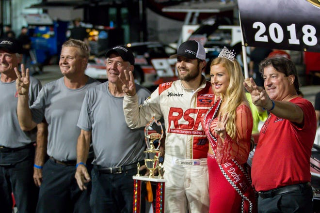 Casey Roderick (white race suit) and his girlfriend, former Miss Snowball Derby queen Emalee Hodge, along with his crew members after winning the Blizzard Series points championship Sept. 22 for a third time at Five Flags Speedway.