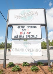 The sign for Wolf Bay at Perdido hangs outside the restaurant Wednesday.