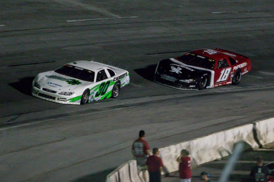 Jesse Dutilly (30) and Casey Roderick (18) head into turn four in the Deep South Cranes 150 Blizzard Championship race at Five Flags Speedway on Saturday, Sept. 22, 2018. Bubba Pollard won the race and Roderick won the points championship for the series. Roderick tied Pollard with three points championship wins over the years.