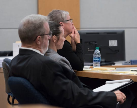 Mary Rice, center, and her defense team watch the video of her police interview during her trial at the Escambia County Courthouse in Pensacola on Wednesday, September 26, 2018.