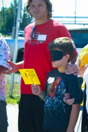 A father and son participate in a previous Cane and Able Day.