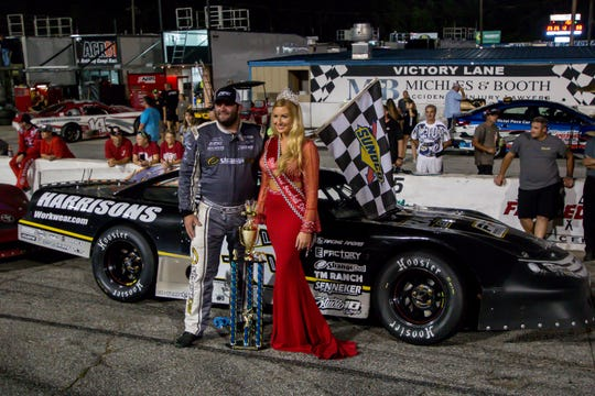 Bubba Pollard with current Miss Snowball Derby, Emalee Hodge, after winning the Deep South Cranes 150 Blizzard Championship race at Five Flags Speedway on Saturday, Sept. 22, 2018.