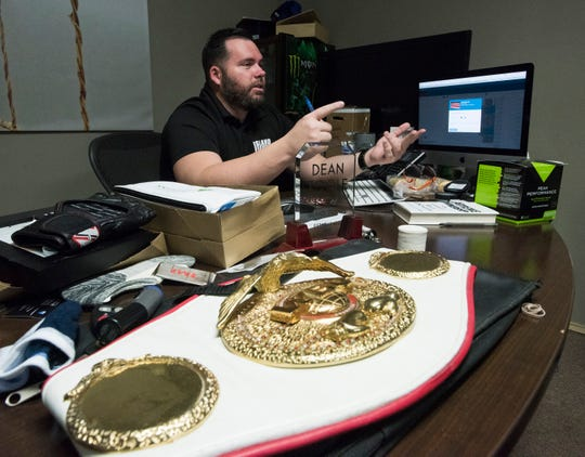 Island Fights CEO and Founder, Dean Toole, spends Wednesday, Sept. 26, 2018, finalizing plans for the organization's upcoming bouts on at the Pensacola Bay Center.  Island Fights will celebrate its 50th event this weekend.