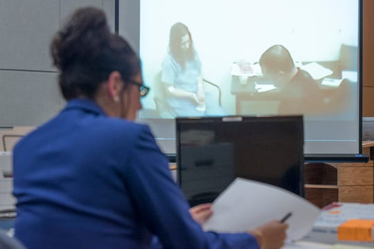 Prosecutor jots a note while watching the video of Mary Rice's police interview during trial at the Escambia County Courthouse in Pensacola on Wednesday, September 26, 2018.