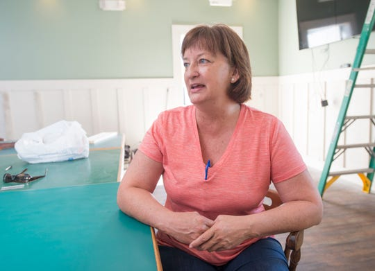 Carol Ard, owner of Trigger's Seafood Restaurant, talks Wednesday about selling the business to Wolf Bay at Perdido.