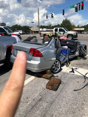 A Gulf Breeze woman had to be extricated from her Honda sedan and airlifted to Baptist Hospital following a two-car collision Wednesday morning on U.S. 98.
