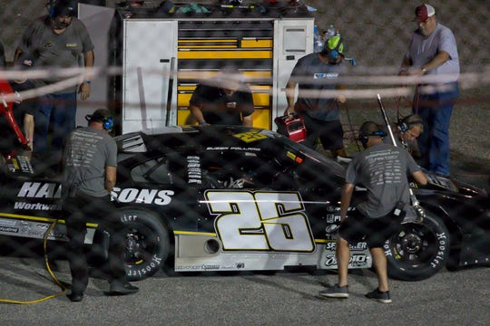 Crew members work on Bubba Pollard's car during a caution in the Deep South Cranes 150 Blizzard Championship race at Five Flags Speedway on Saturday, Sept. 22, 2018.