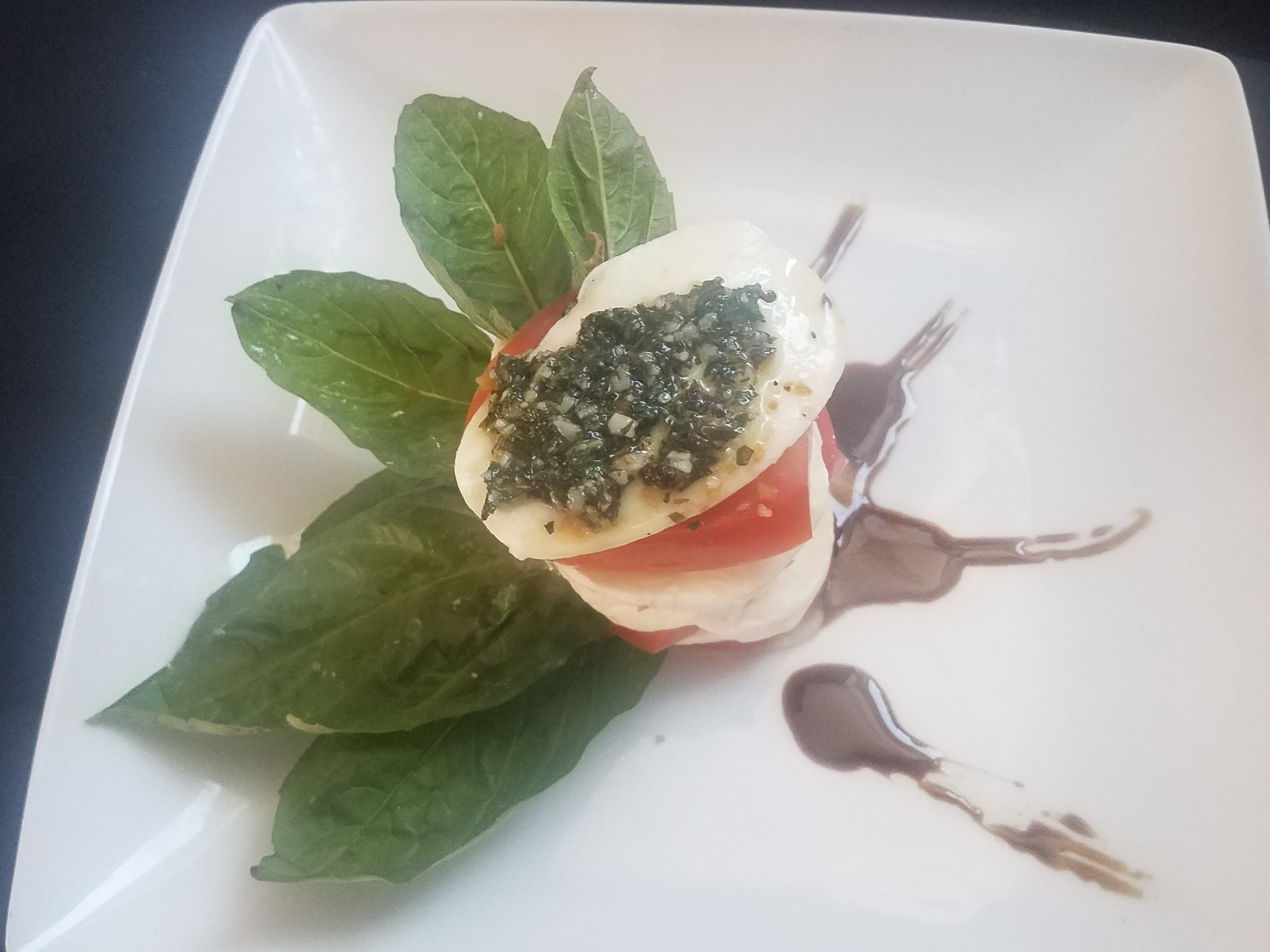 Stacked caprese pesto with a honey balsamic reduction from Sundial Garden Cafe in Carefree.