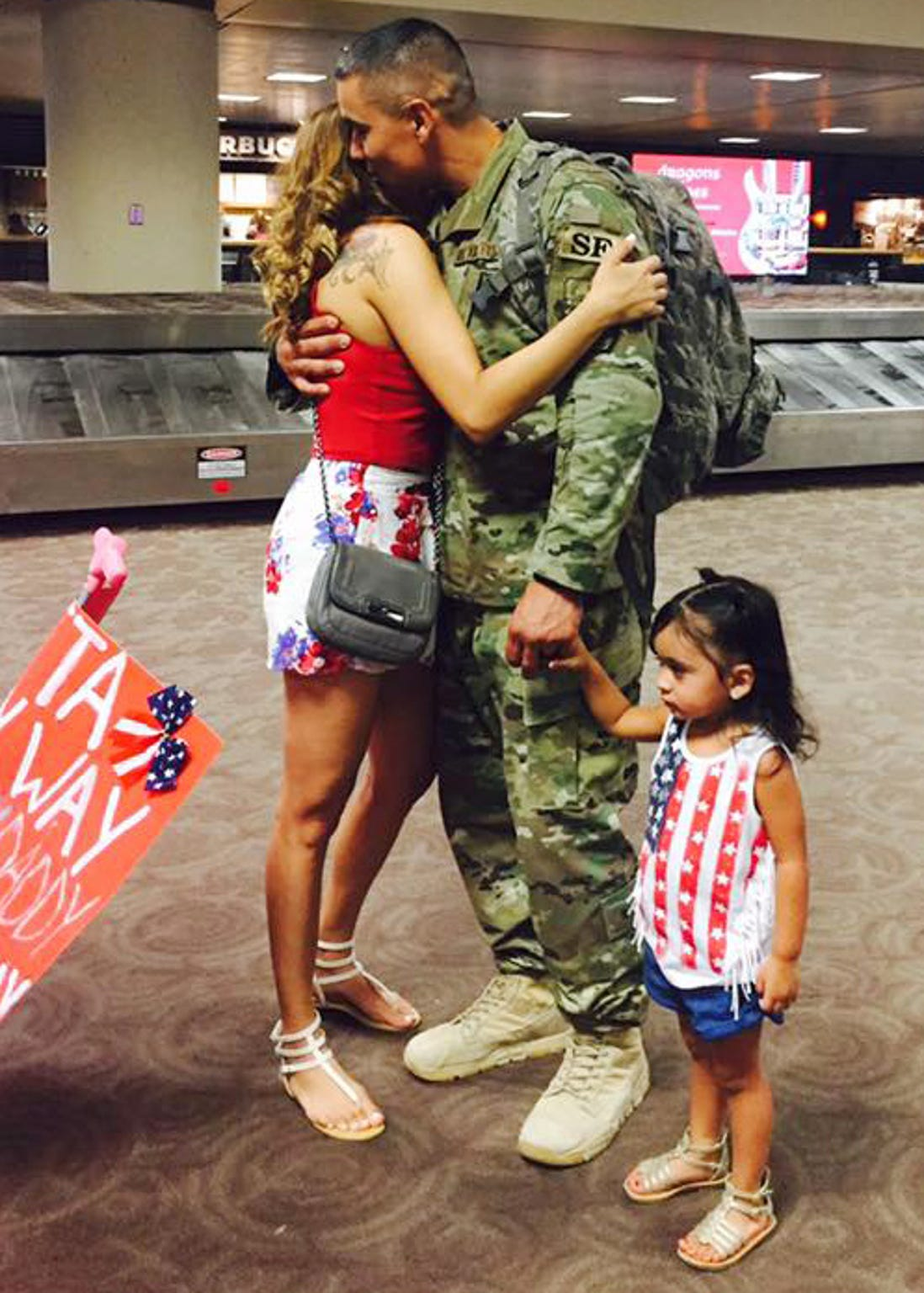 Jovanna Calzadillas hugs her husband Frank Calzadillas after he returned from deployment.