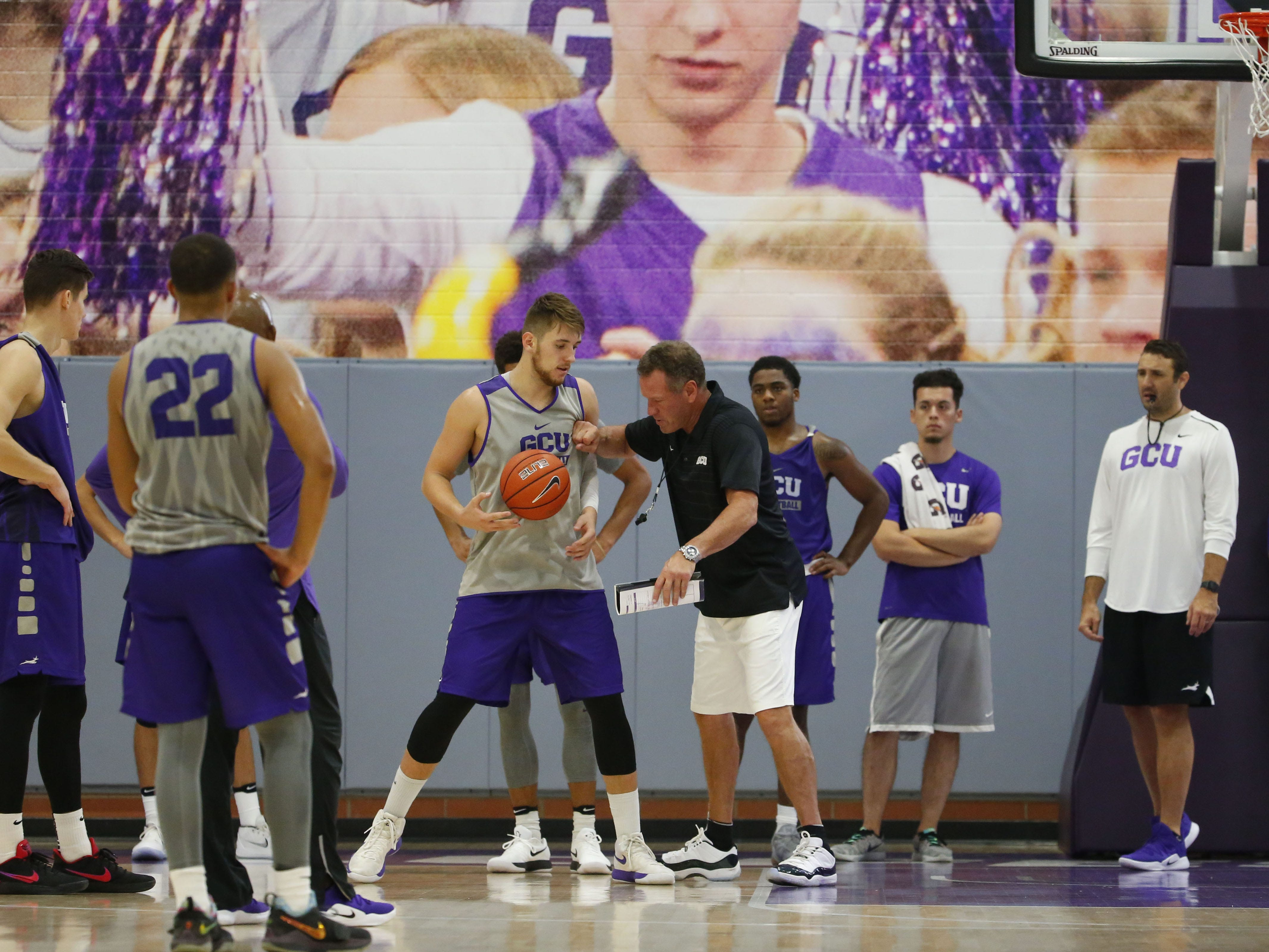 Grand Canyon University head basketball coach Dan Majerle works with forward Alessandro Lever, (25), during practice in the gym in Phoenix on September 26, 2018.