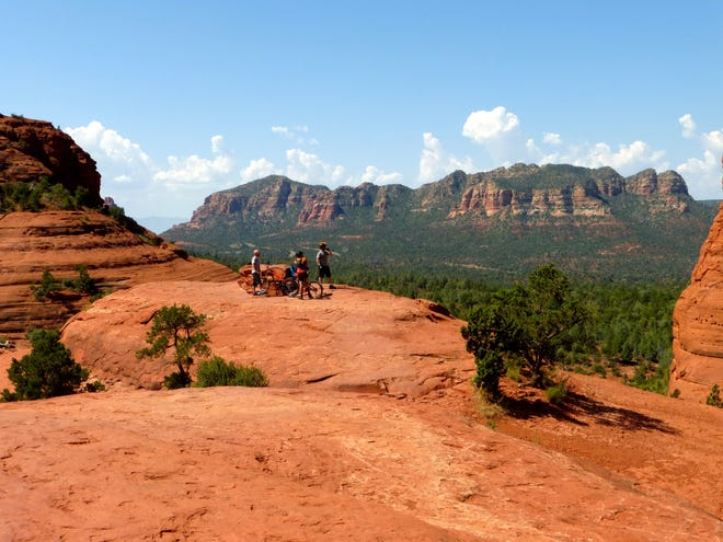 Hikers and bikers enjoy the views from Chicken Point, accessible from the Little Horse Trail, as well as the Broken Arrow Trail in Sedona.