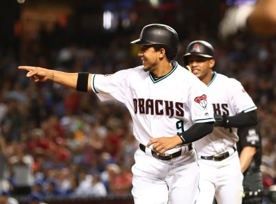 Sep 25, 2018: Arizona Diamondbacks outfielder Jon Jay reacts after scoring in the sixth inning against the Los Angeles Dodgers at Chase Field.