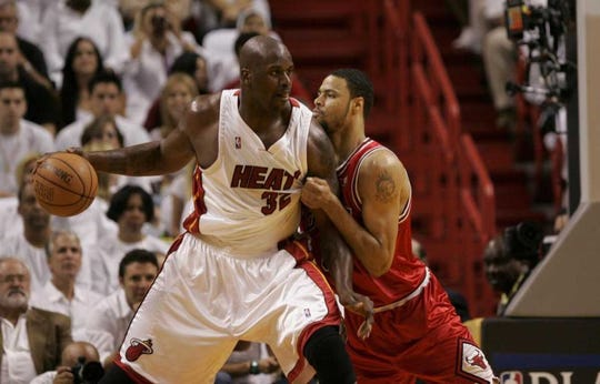 A much-younger Tyson Chandler tries to defend Shaquille O'Neal in the NBA playoffs.