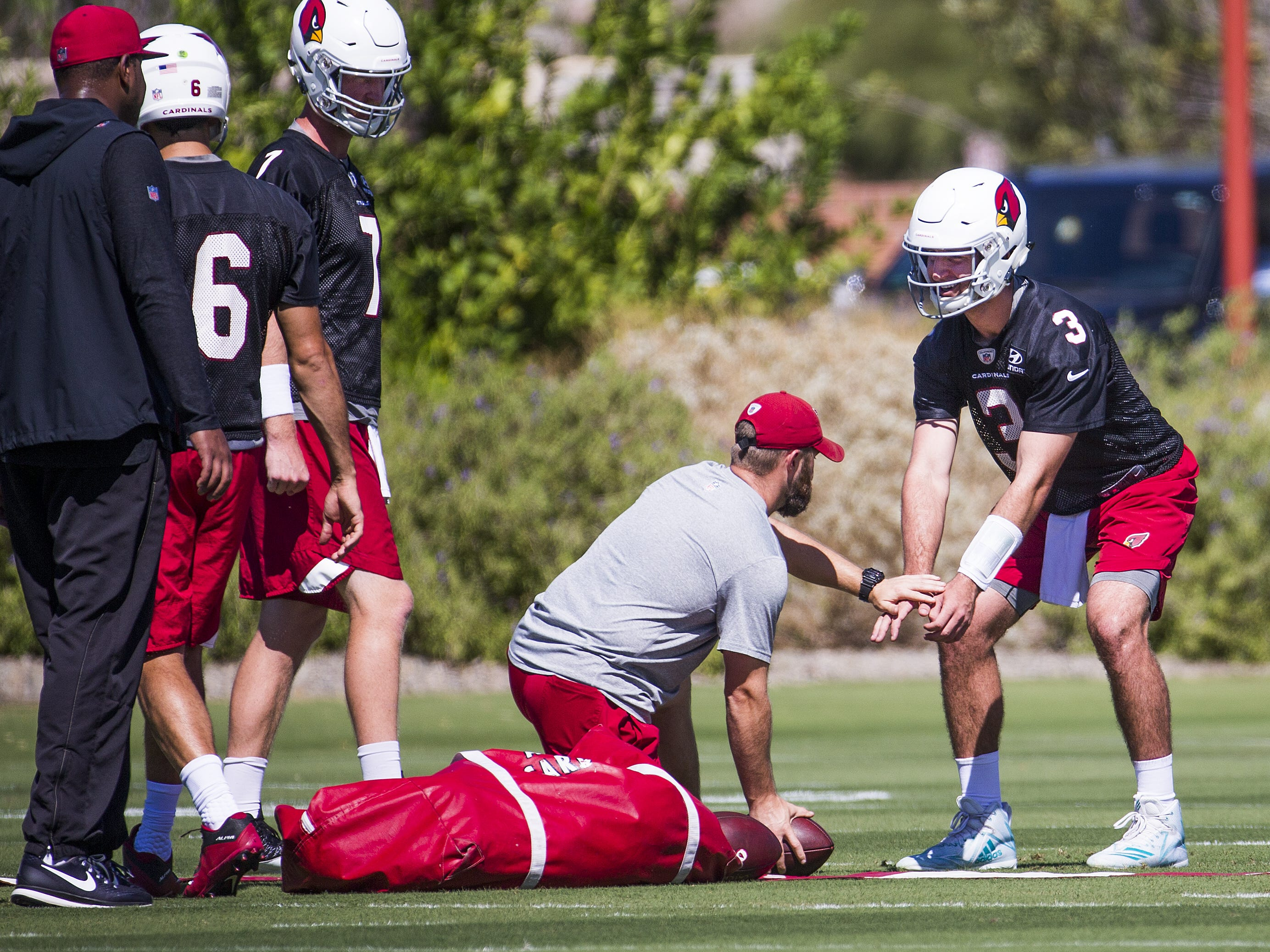 Arizona Cardinals quarterback Josh Rosen prepares to take a snap during practice at the Tempe training facility, Wednesday, September 26, 2018.