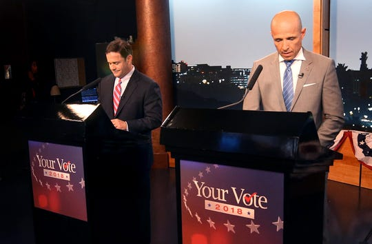 Gubernatorial candidates Republican Doug Ducey, left, and Democrat David Garcia prepare in the last minutes before a televised debate in the AZPM studios, Tuesday, Sept. 25, 2018, in Tucson.