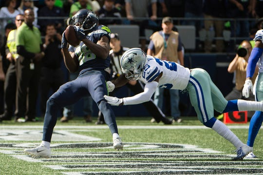 Seattle Seahawks wide receiver Jaron Brown makes a touchdown catch against Dallas Cowboys on Sept. 23, 2018 at CenturyLink Field.