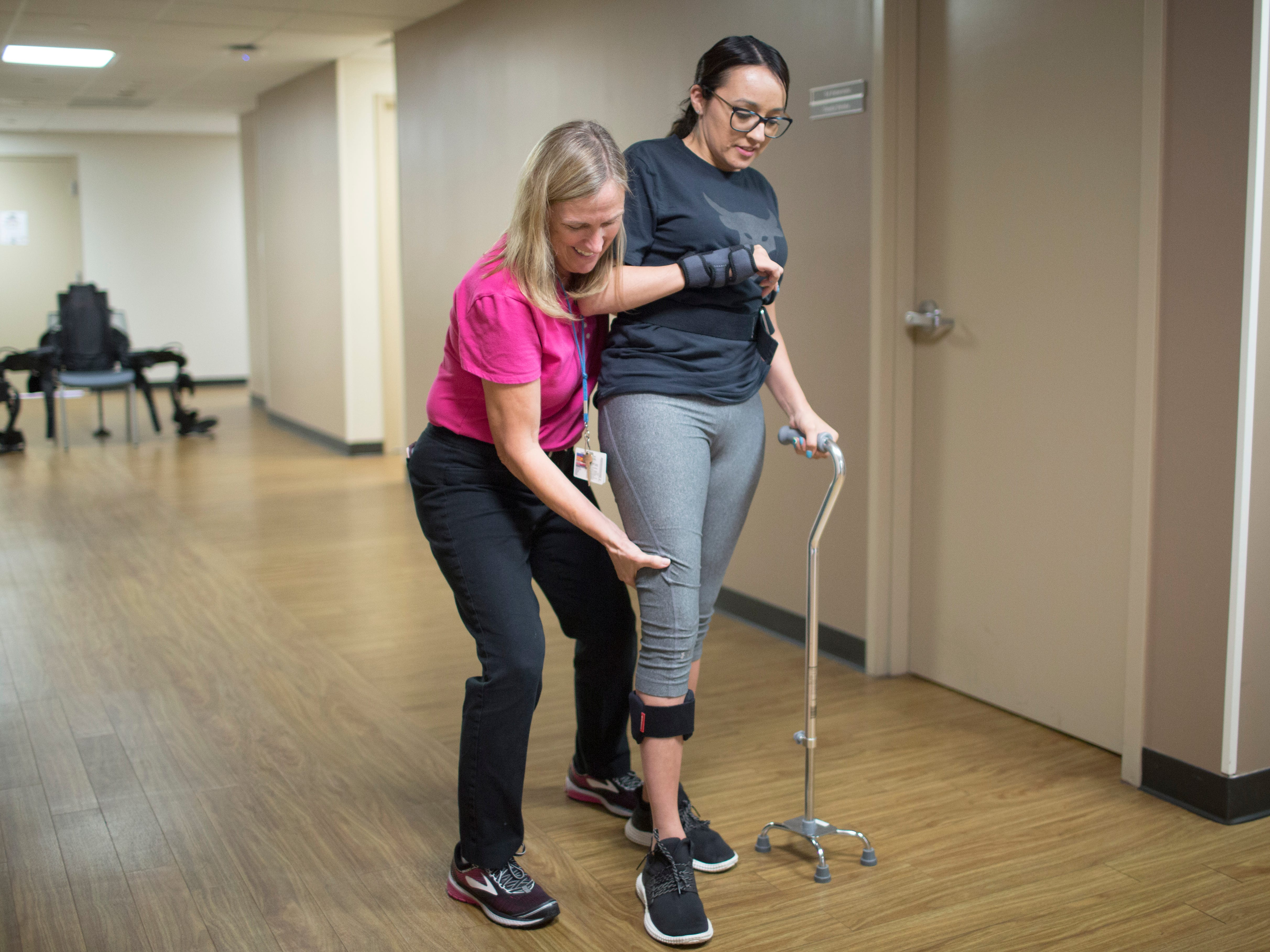 Jovanna Calzadillas works with physical therapist Patty Briody at the Barrow Center for Transitional Neuro- Rehabilitation. She is learning to walk again after being shot in a mass shooting in Las Vegas.