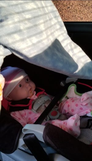 The Arizona Department of Public Safety said this doll was strapped into the car seat of a Chandler woman who had been driving in the carpool lane of a Phoenix-area freeway on September 11, 2018.
