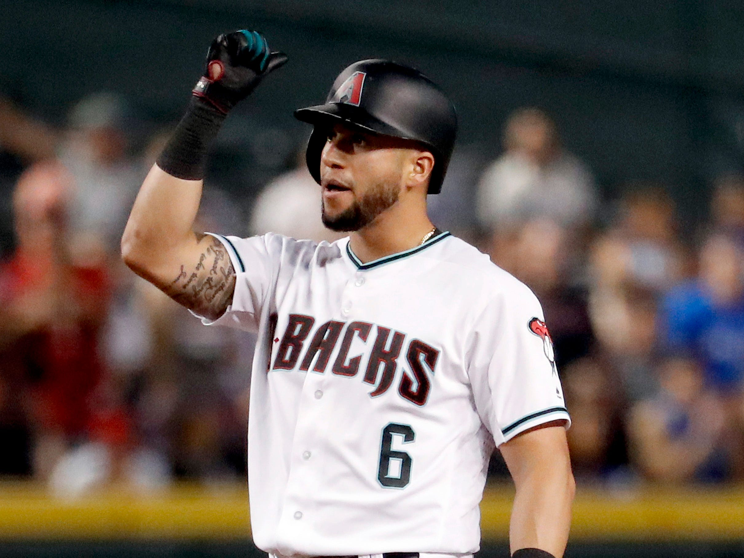 Arizona Diamondbacks' David Peralta (6) celebrates his two-run double against the Los Angeles Dodgers during the sixth inning of a baseball game Tuesday, Sept. 25, 2018, in Phoenix.