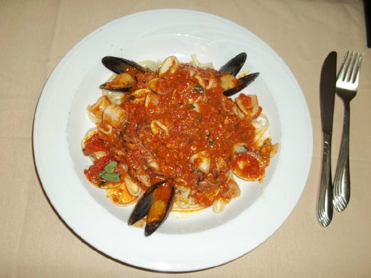 Linguine con vongole, pasta with baby clams and red tomato sauce, from Giordano's Trattoria Roman Italian Restaurante in Carefree.