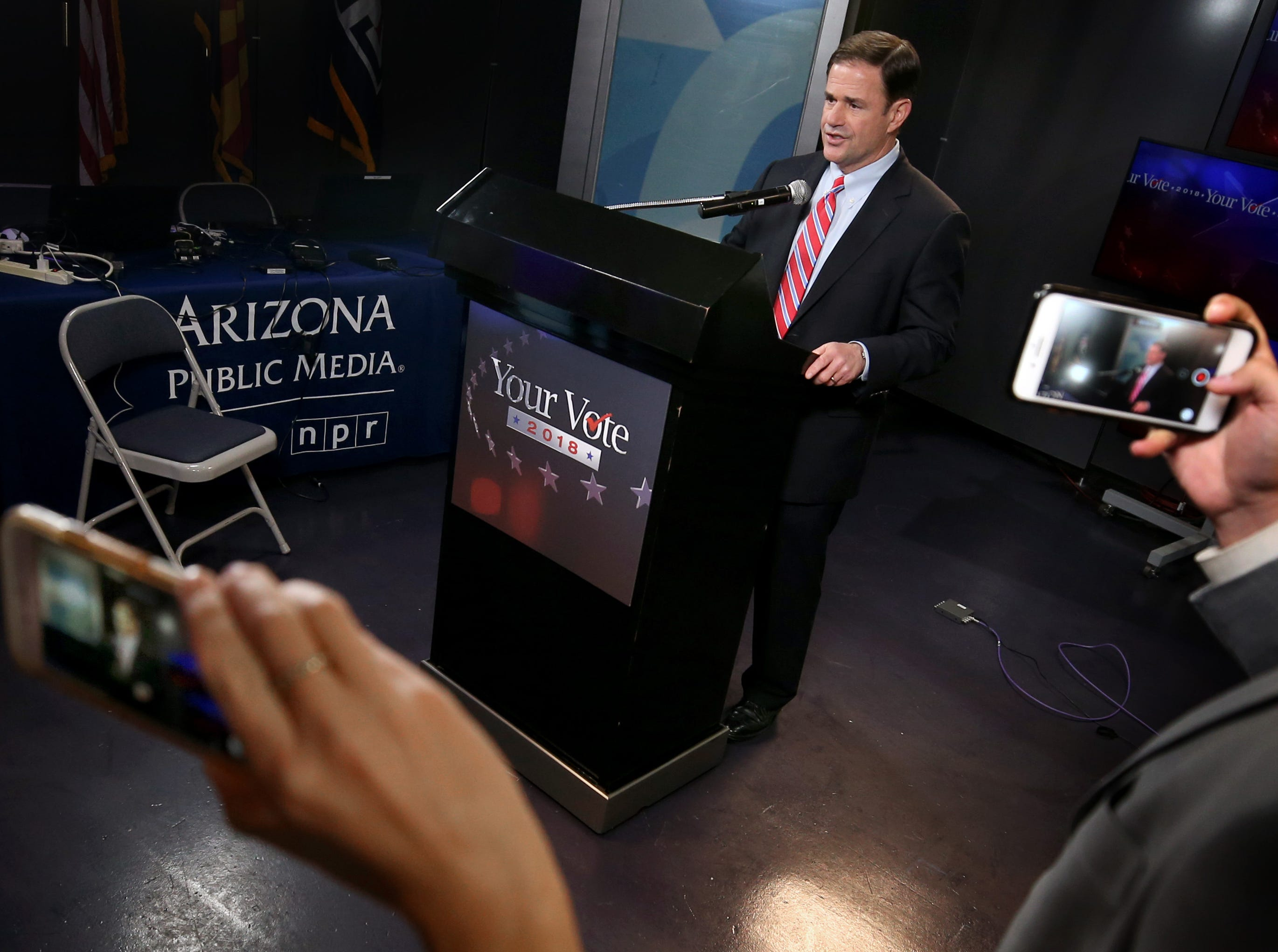 Gubernatorial candidate Republican Doug Ducey gives a few remarks as staffers get cell phone videos, after a televised debate in the AZPM studios, Tuesday, Sept. 25, 2018, in Tucson.