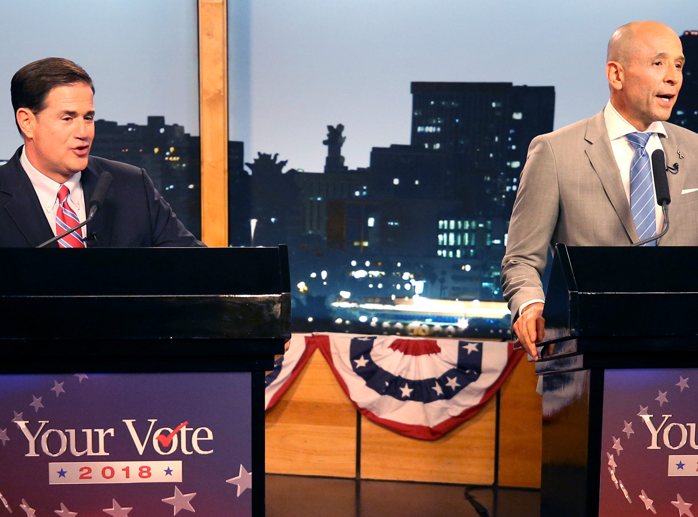 Gubernatorial candidates Republican Doug Ducey, left, and Democrat David Garcia at a televised debate in the AZPM studios, Tuesday, Sept. 25, 2018, in Tucson.
