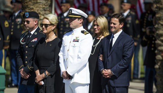 Cindy McCain and her family, along with Gov. Doug Ducey and his wife, wait for Sen. John McCain'scasket to be taken from the hearse  Aug. 29, 2018, at the Capitol in Phoenix.