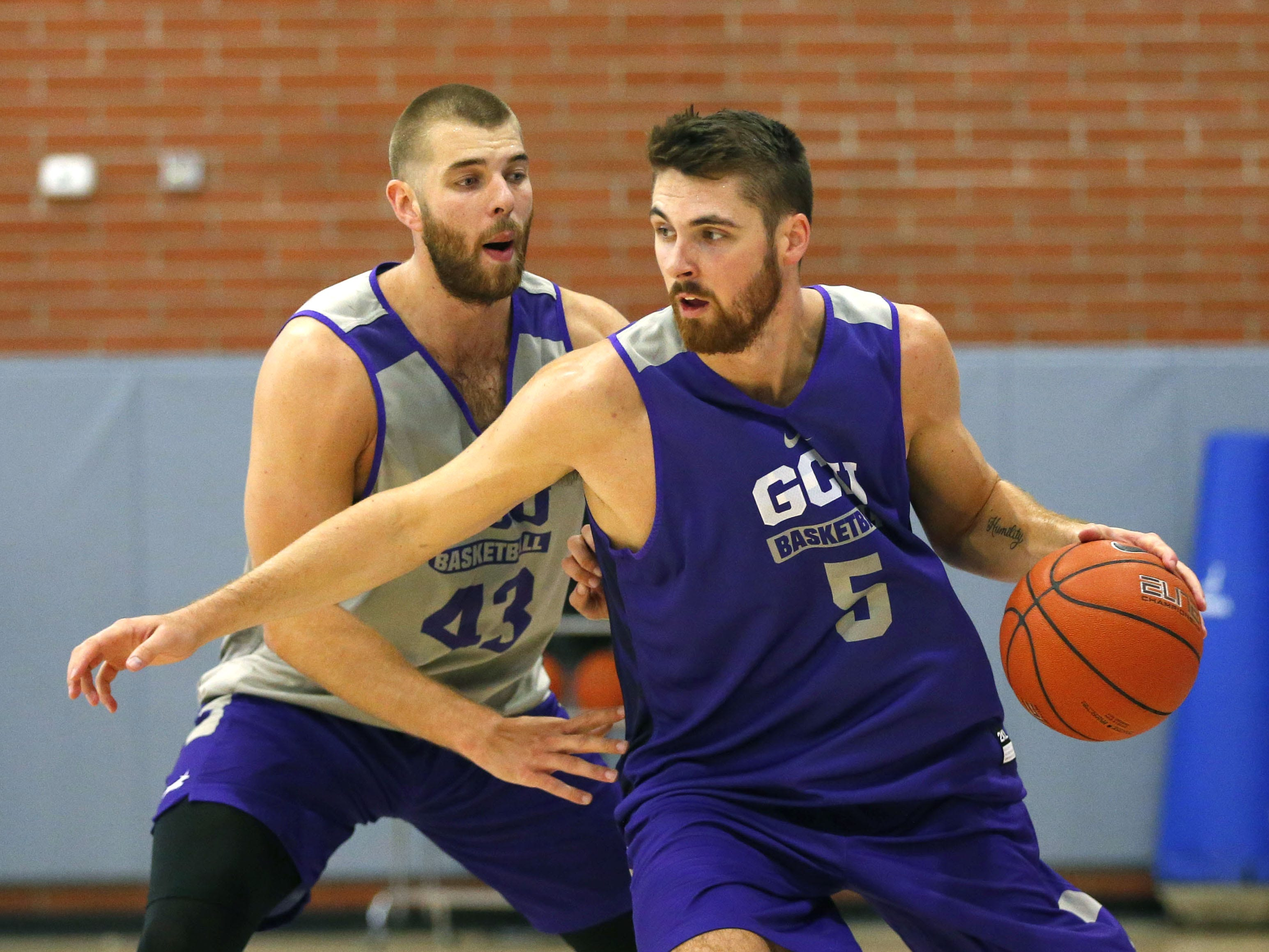 Grand Canyon University forward Michael Finke, (43) guards forward Matt Jackson, (5)  during practice in the gym in Phoenix on September 26,  2018.