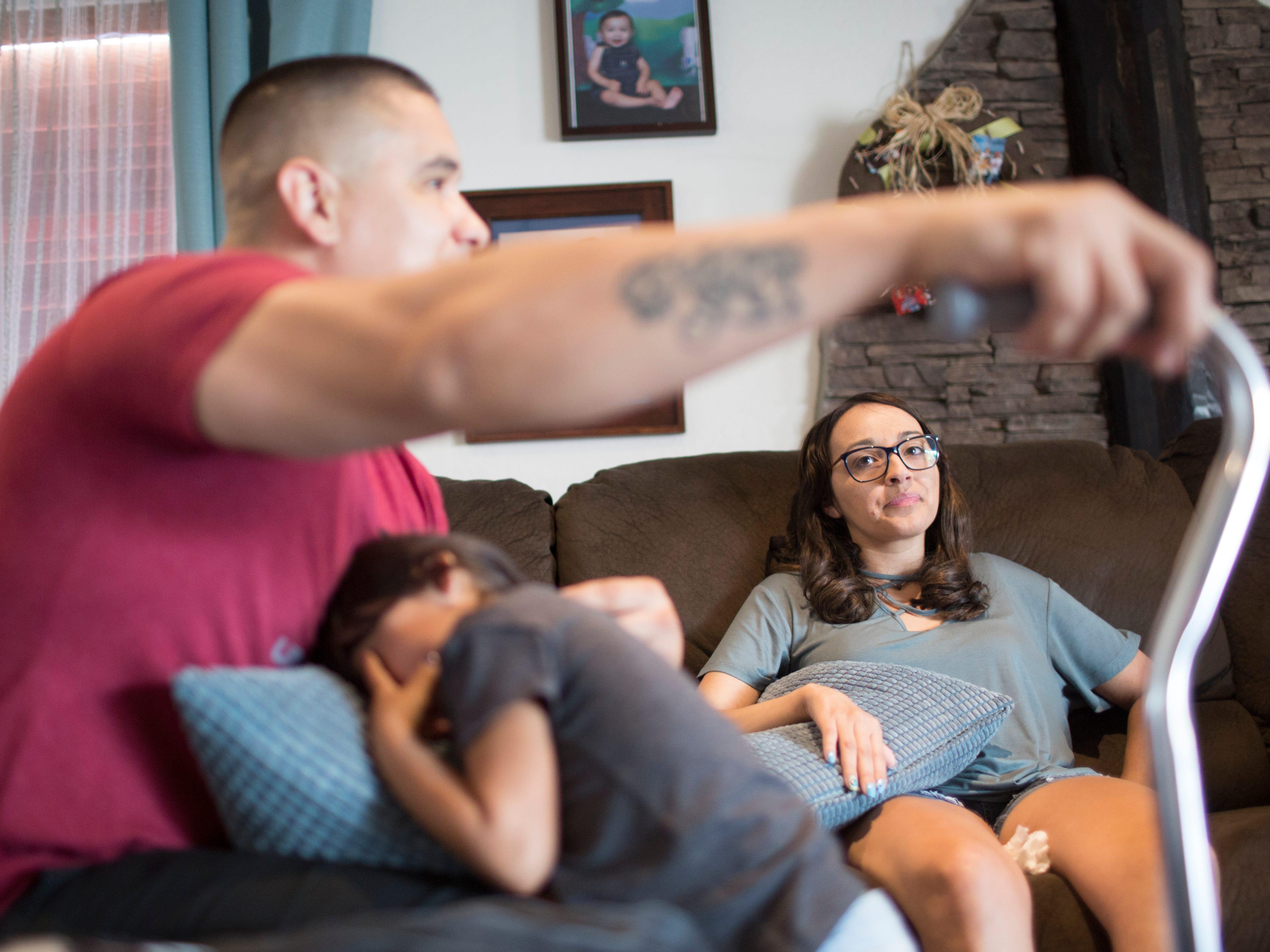 Jovanna Calzadillas and Frank Calzadillas  in their home.