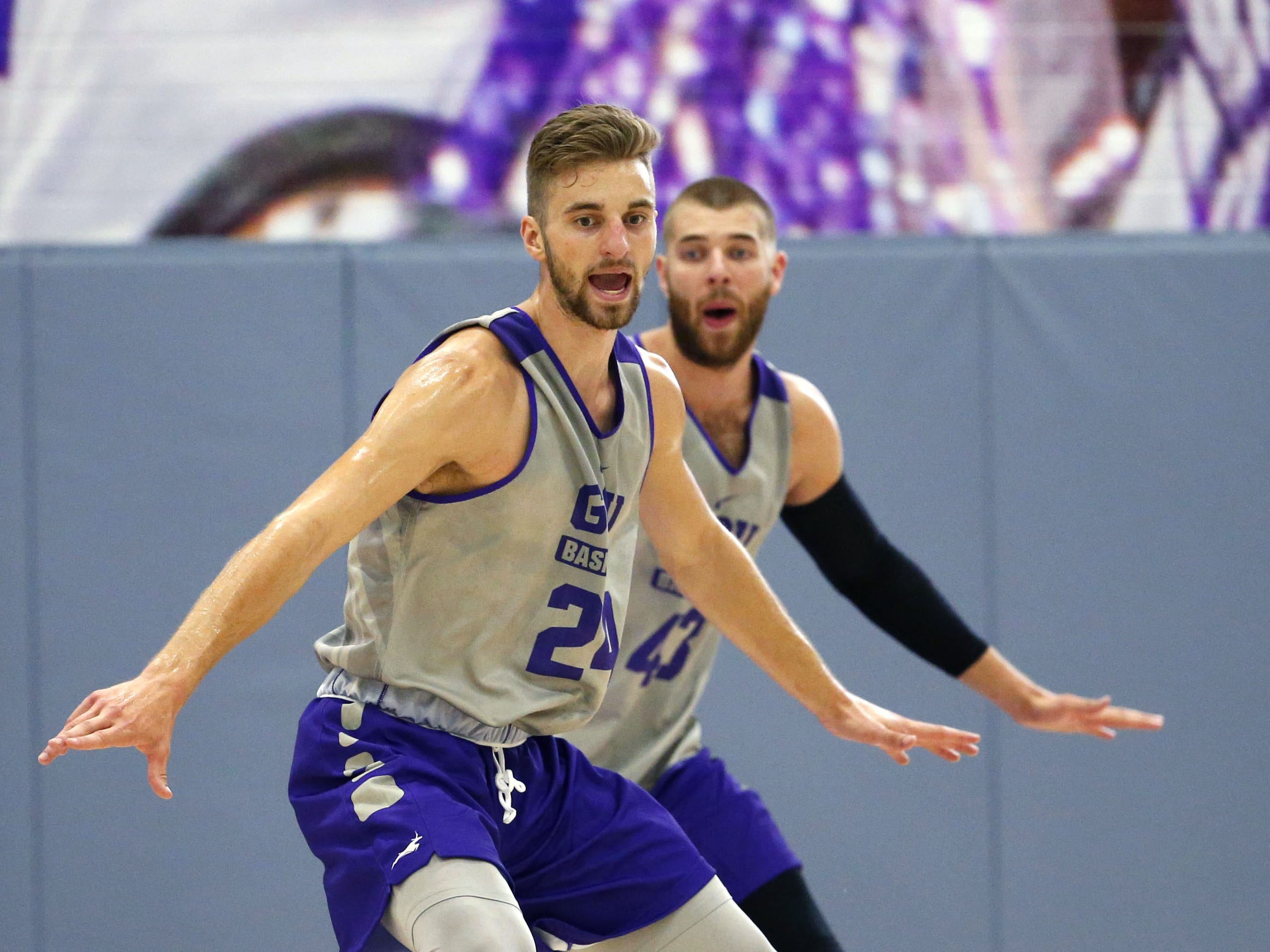 Grand Canyon University's Tim Finke, (24), and Michael Finke, (43),  run a drill during practice in the gym in Phoenix on September 26,  2018.