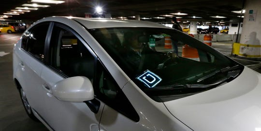 Arizona Uber drivers whose personal information was stolen by hackers will get $100 each in a nationwide lawsuit settlement. A driver for Uber Technologies Inc. arrives at Seattle-Tacoma International Airport.