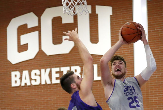 Grand Canyon University forward Matt Jackson, (5), guards Alessandro Lever, (25), during practice in the gym in Phoenix on September 26,  2018.