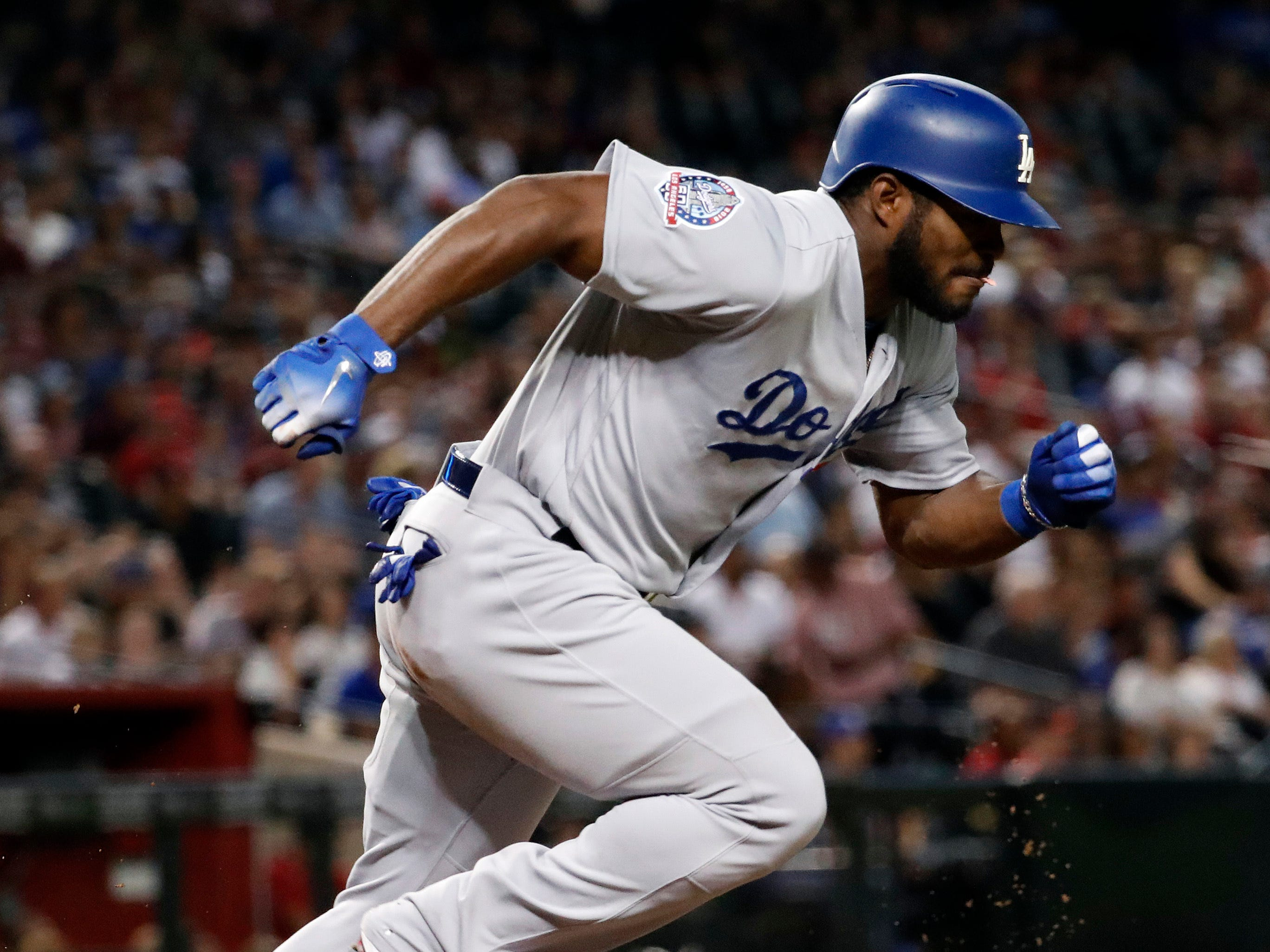 Los Angeles Dodgers right fielder Yasiel Puig hits against the Arizona Diamondbacks during the fifth inning of a baseball game, Tuesday, Sept. 25, 2018, in Phoenix.