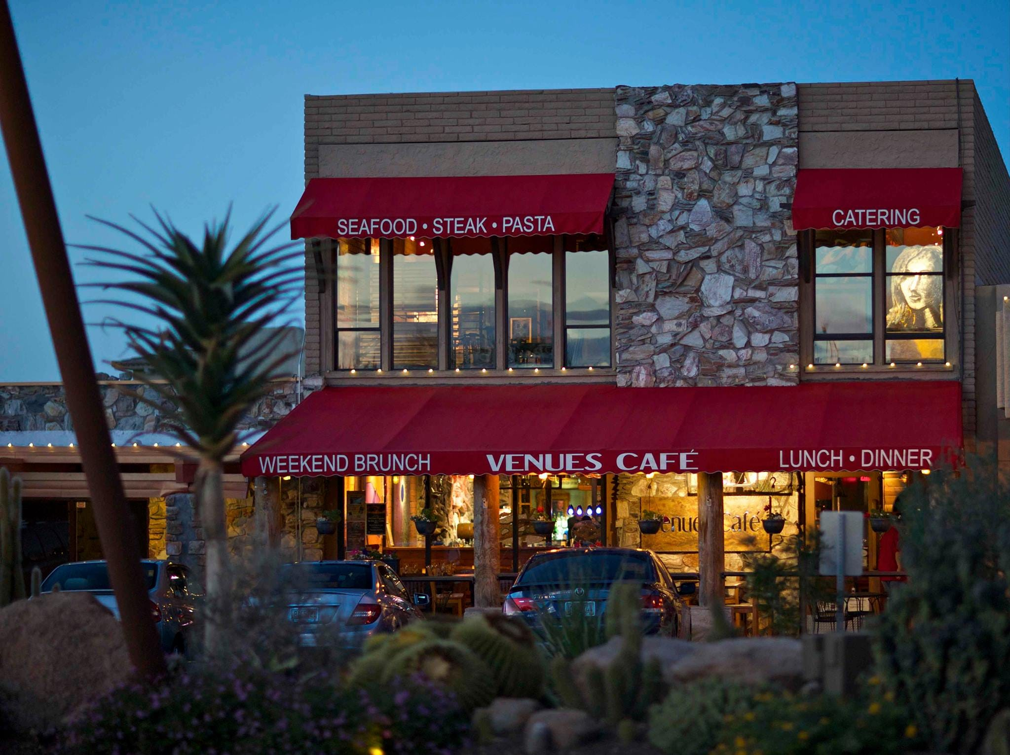 "An exterior evening view of Venues Cafe in Carefree which bills its cuisine as ""comfort food with a Southwest flair."""