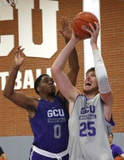 Grand Canyon University's J.J. Rhymes, (0), guards Alessandro Lever, (25), during practice in the gym in Phoenix on September 26,  2018.