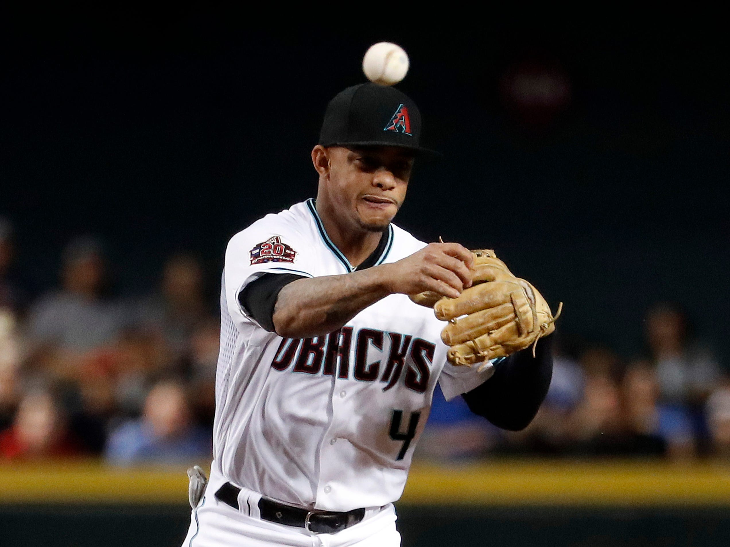 Arizona Diamondbacks' Ketel Marte throws to first against the Los Angeles Dodgers during the third inning of a baseball game, Tuesday, Sept. 25, 2018, in Phoenix. (AP Photo/Matt York)