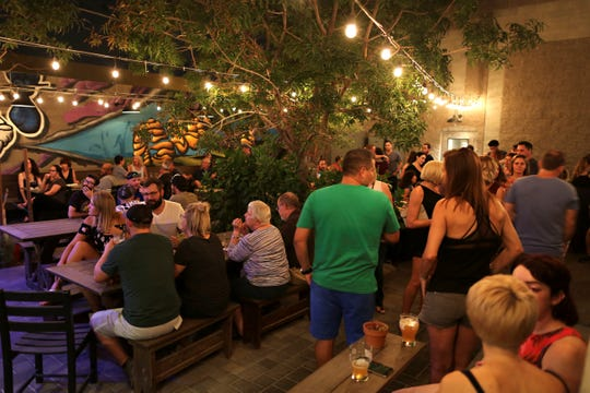 The patio at the Shop Beer Co. in Tempe is one of our picks for best patio bars.