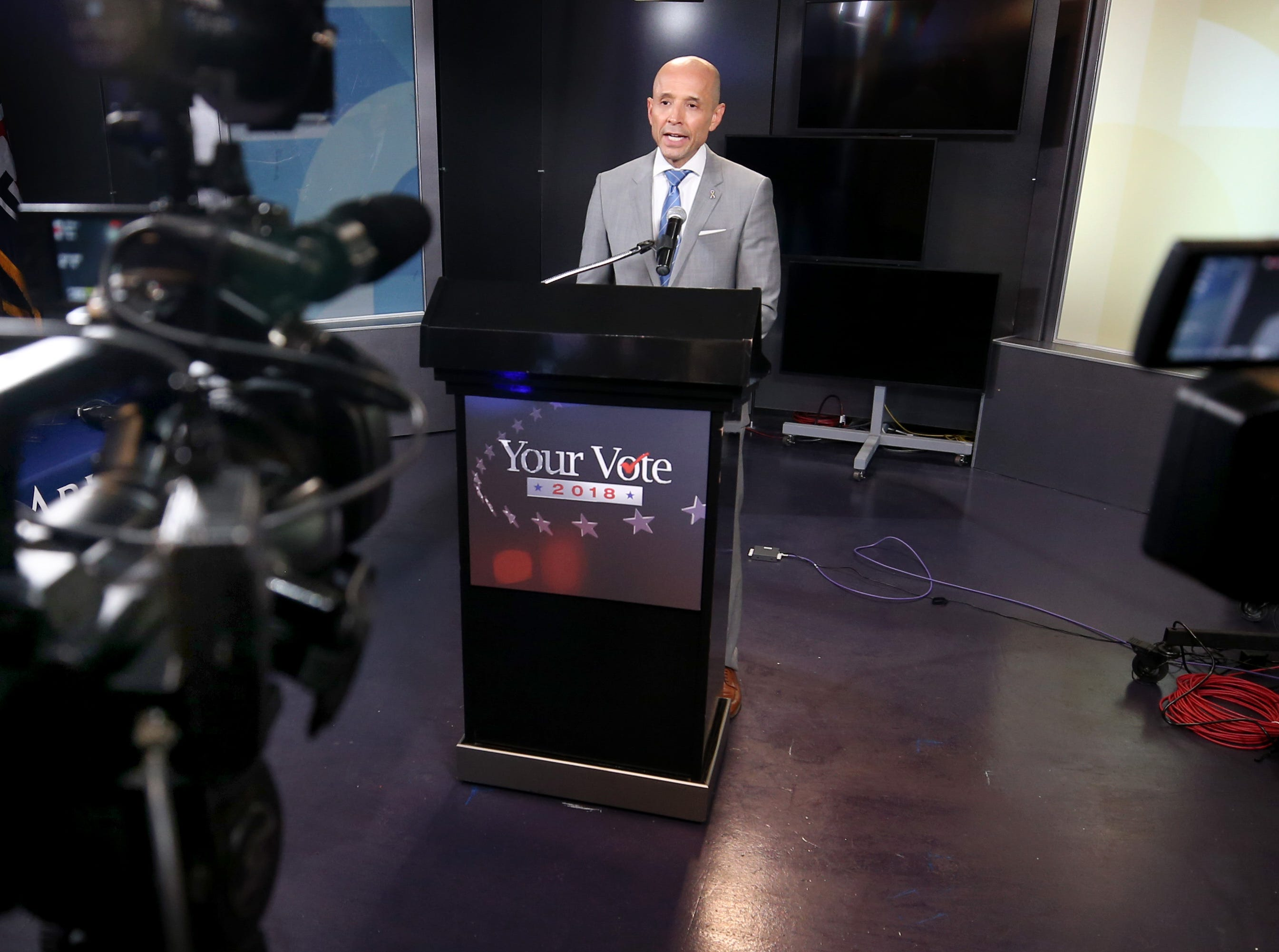 Gubernatorial candidate Democrat David Garcia gives a few remarks to the media follwing a televised debate in the AZPM studios, Tuesday, Sept. 25, 2018, in Tucson.