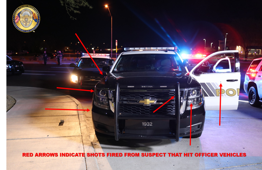 Red arrows indicate where shots fired from Stout struck the officer's vehicle on Monday night.