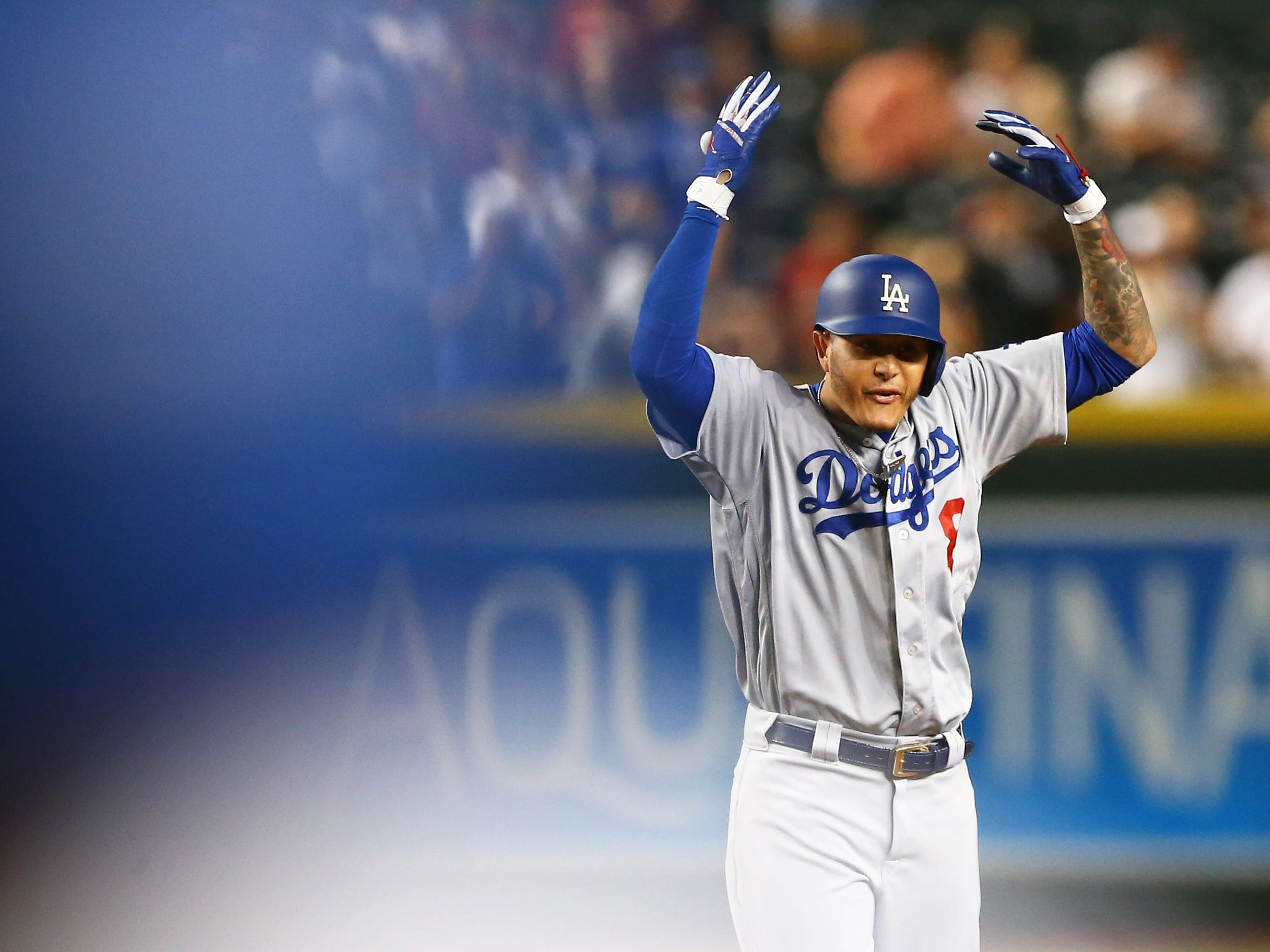 Sep 25, 2018: Los Angeles Dodgers shortstop Manny Machado celebrates after hitting an eighth inning double against the Arizona Diamondbacks at Chase Field.