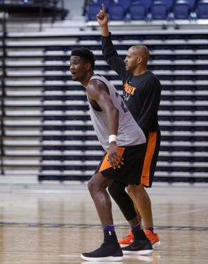 Suns rookie center Deandre Ayton runs a drill with assistant coach Corliss Williamson during a training camp practice Wednesday at Northern Arizona.