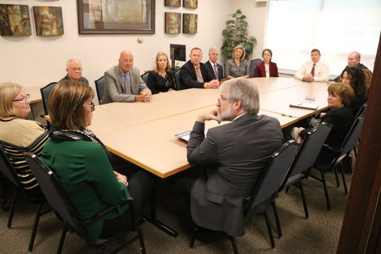 Paolo DeMaria, Ohio's superintendent of public instruction, visited with Ottawa County officials at GenoaBank to discuss collaboration between business and education.