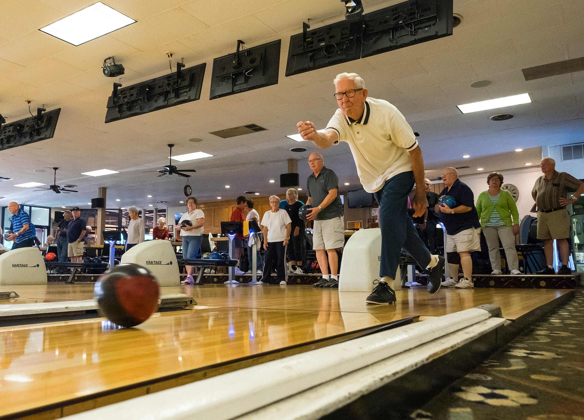 Bob Crorey, of China Township, rolls a bowling ball down one of the lanes at the Voyageur in St. Clair Wednesday, Sept. 26, 2018 while warming up for a seniors bowling league meet.