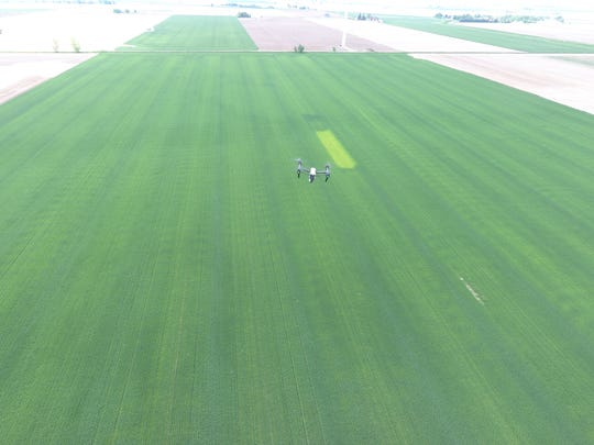 A drone flies over a farm field in the Thumb.