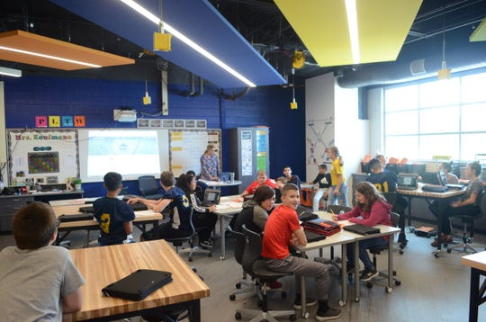 Central Middle School students use their personally assigned Chromebooks in STEAM teacher Randi Kaufman's medical detectives class on Sept. 26, 2018, in Port Huron.
