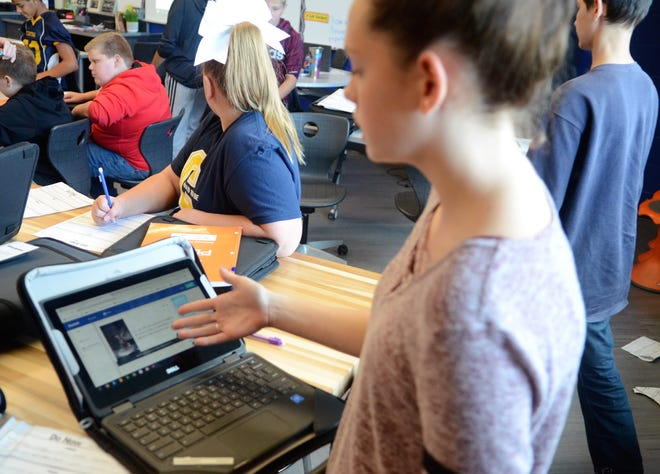 Tori Dunn, 13, demonstrates different programs she uses on her Chromebook in STEAM teacher Randi Kaufman's medical detectives class on Sept. 26, 2018, at Central Middle School in Port Huron, Michigan.