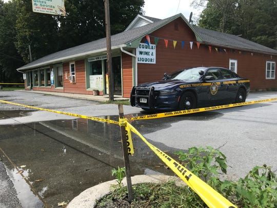 A New York State Trooper sits outside a business on Rt. 82 in Stanfordville following a police involved shooting.